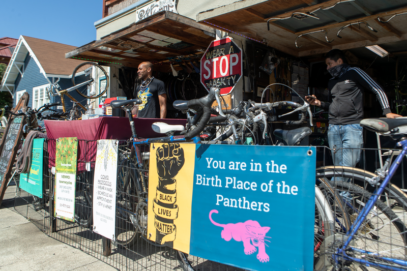 """""""You are in the home of the Black Panthers"""" sign hangs outside of the shop, nearby the former site of Merritt College where Huey P Newton and Bobby Seale first met as students."""