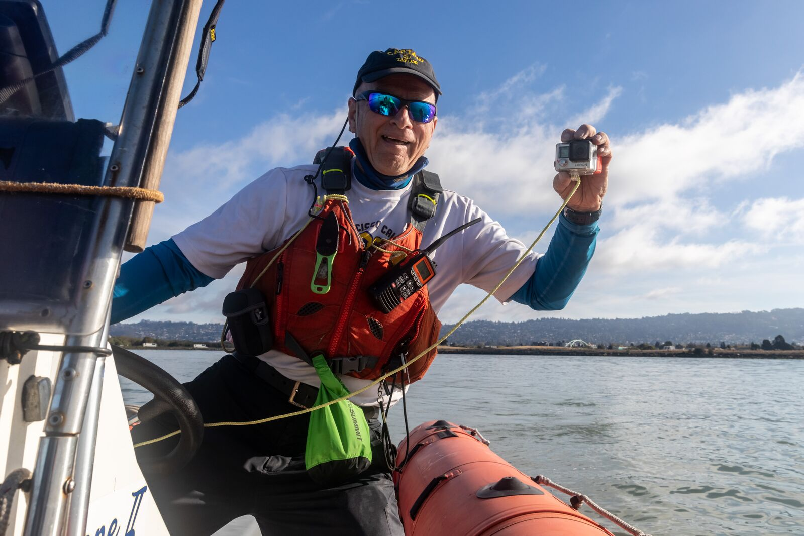 Captain Taylor Hurt uses a waterproof camera to document swimmers in the South Sailing Basin at the Berkeley Marina on September 19, 2021. Credit: Kelly Sullivan