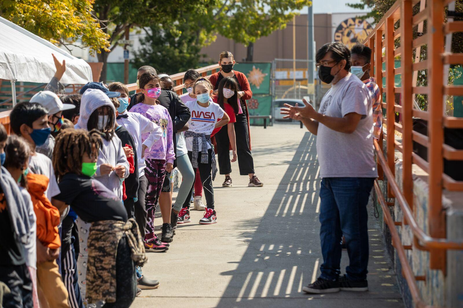 Washington Elementary School 4th grade teacher Oscar Zarate instructs students in physical education on August 16, 2021. Credit: Kelly Sullivan
