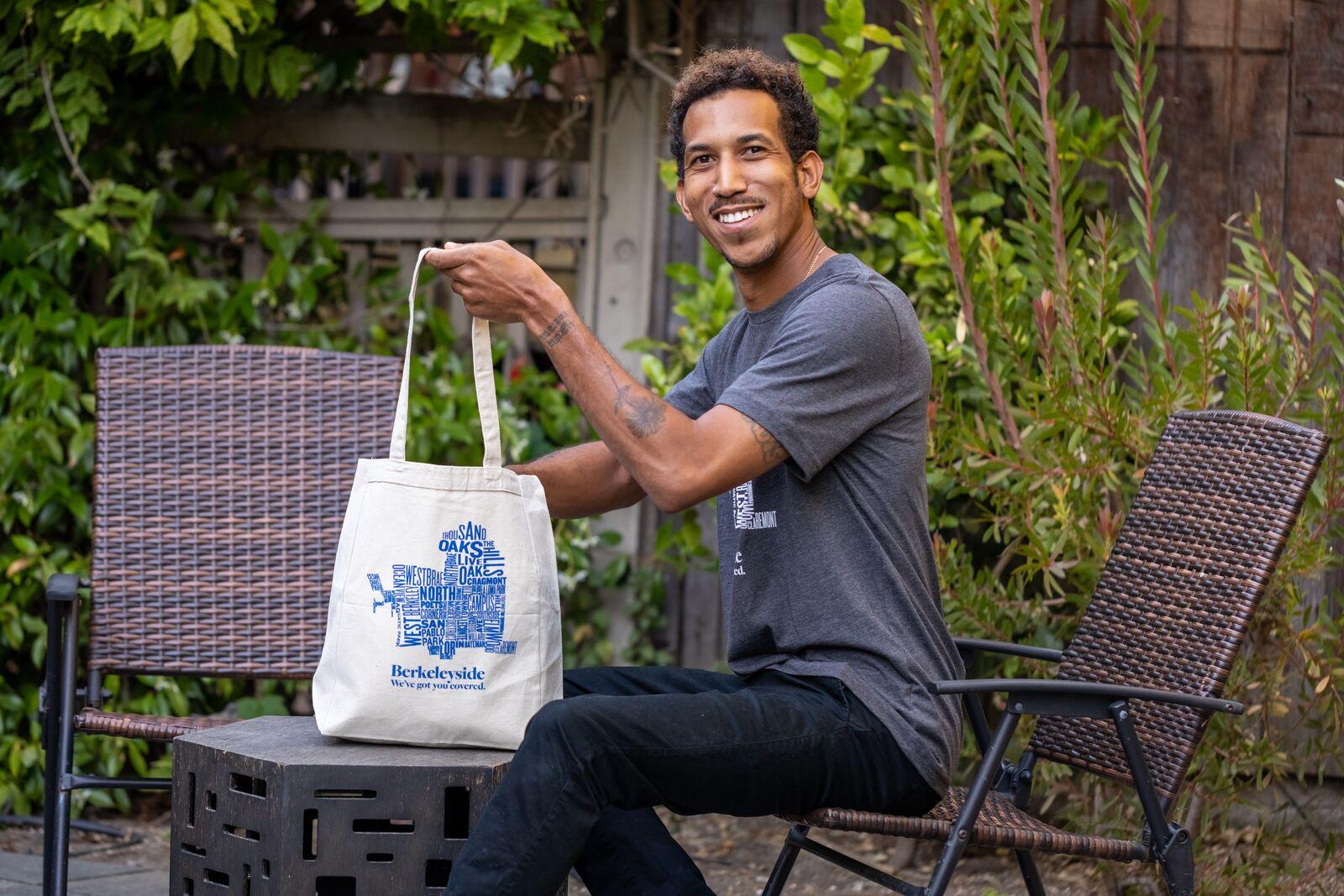 Javier modeling Berkeleyside and Oaklandside T-shirts tote bags