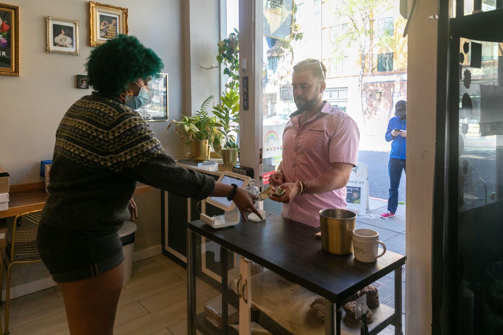 Quiandra Watson takes the order of Derrick Walker at Gold Leaf Cafe on June 15, 2021. Credit: Kelly Sullivan
