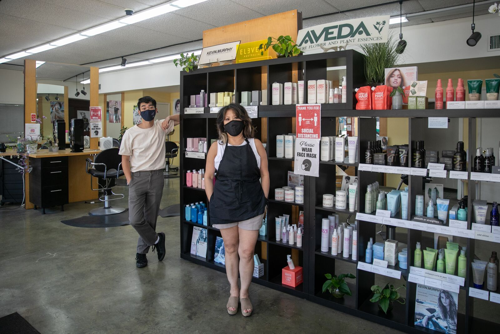 Romello Urbi and Ruby Lynn Urbi at Eclipxe Salon on June 15, 2021. They still require staff to wear masks, but customers are allowed to be unmasked with proof of vaccination. Credit: Kelly Sullivan