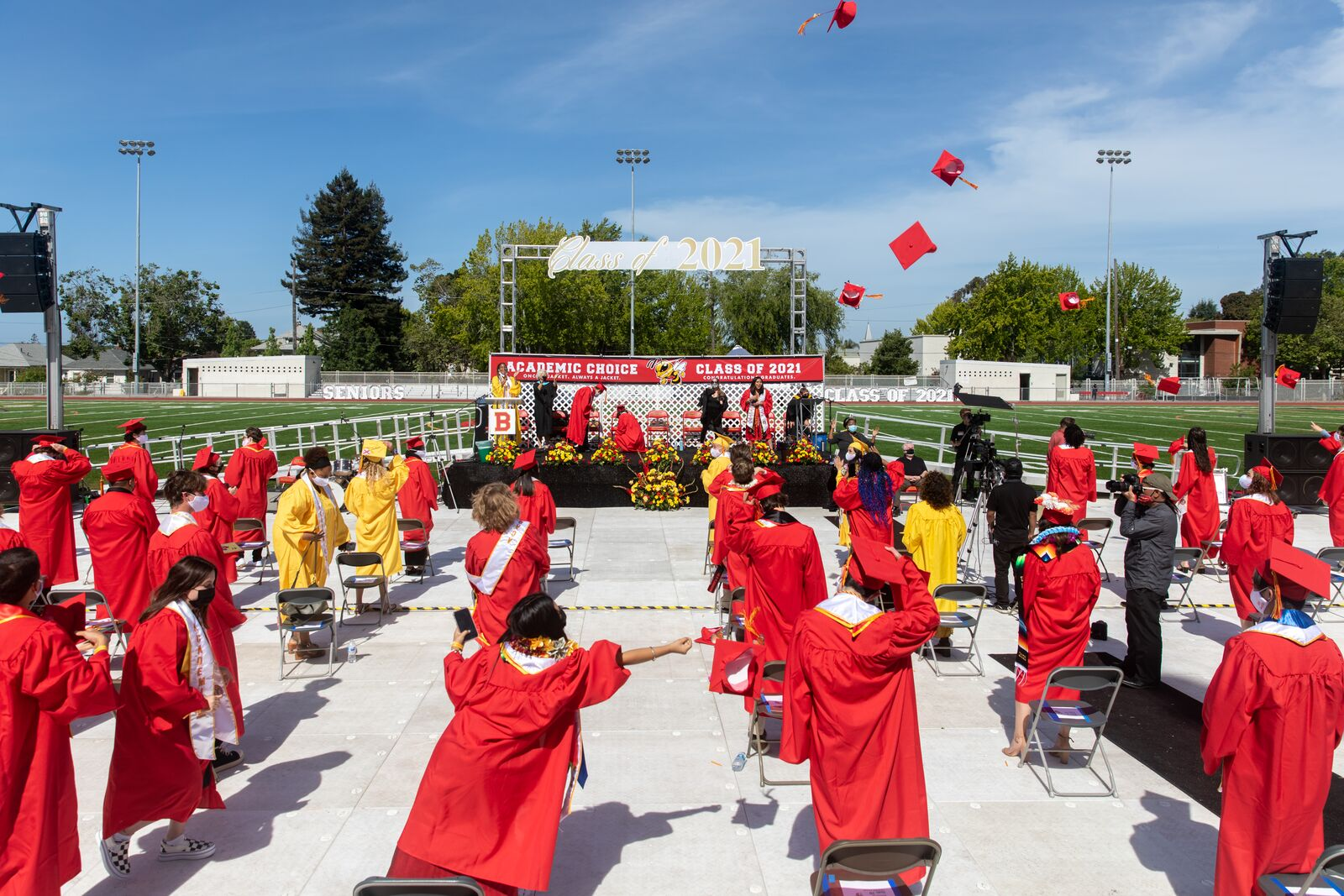 Graduates toss their caps in the air during the Academic Choice graduation ceremony at Berkeley High School on June 5, 2021. Credit: Kelly Sullivan