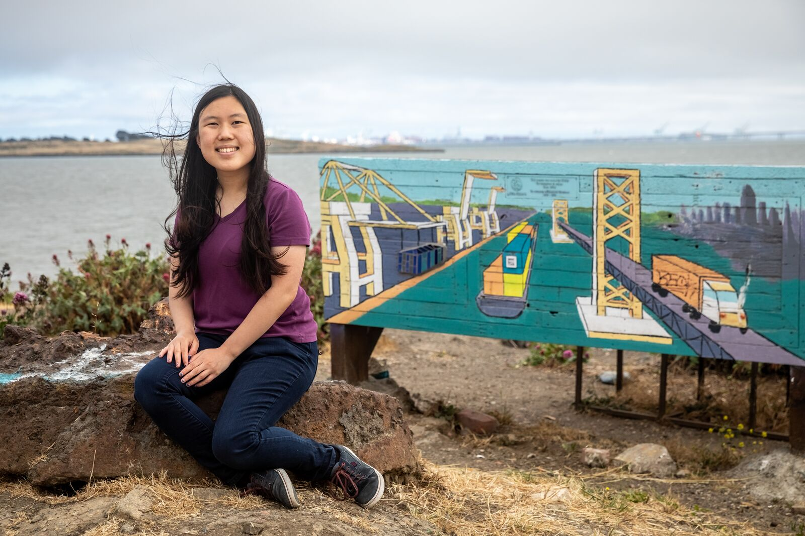 UC Berkeley student Heidi Dong poses for a photo with the installation she co-created at the Albany Bulb. Credit: Kelly Sullivan