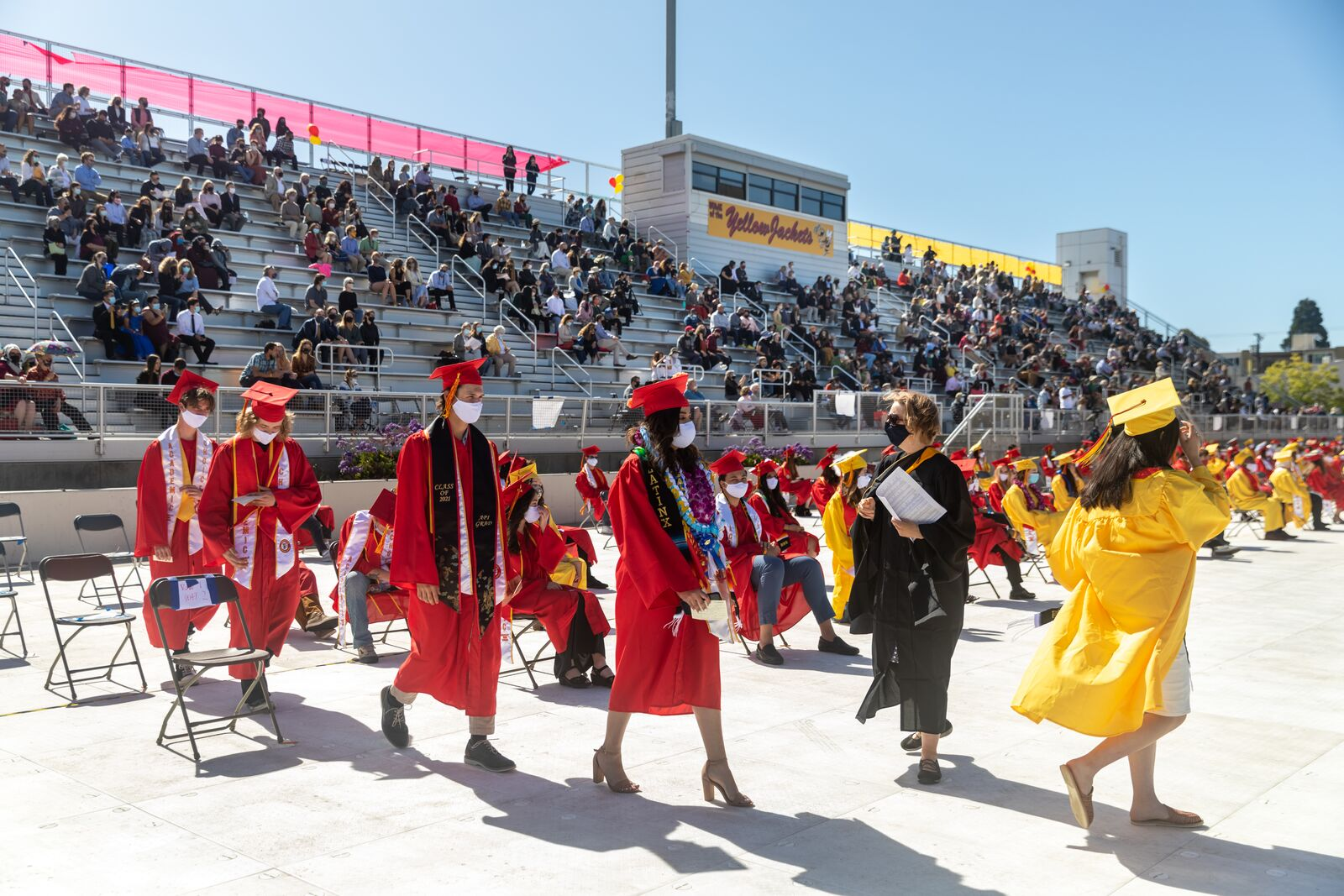 Graduates walk to the stage during the Academic Choice graduation ceremony at Berkeley High School on June 5, 2021. Credit: Kelly Sullivan