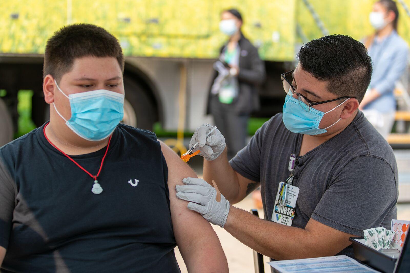 Student Sebastian Melendrez Duran getting the COVID-19 vaccine.