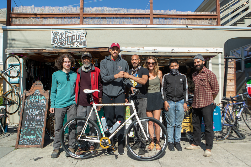 Group photo of JTA and the Towne Cycles shop family and workers.