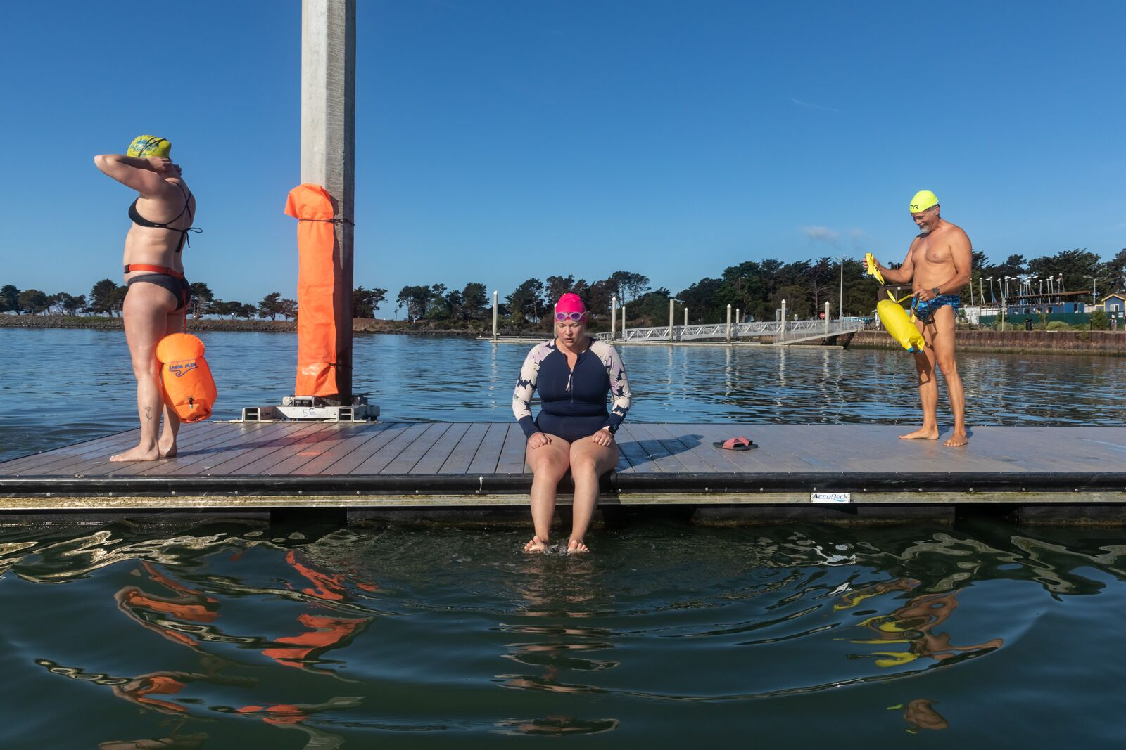 Odyssey open water swimmers prepare to swim in the South Sailing Basin at the Berkeley Marina on September 19, 2021. Credit: Kelly Sullivan