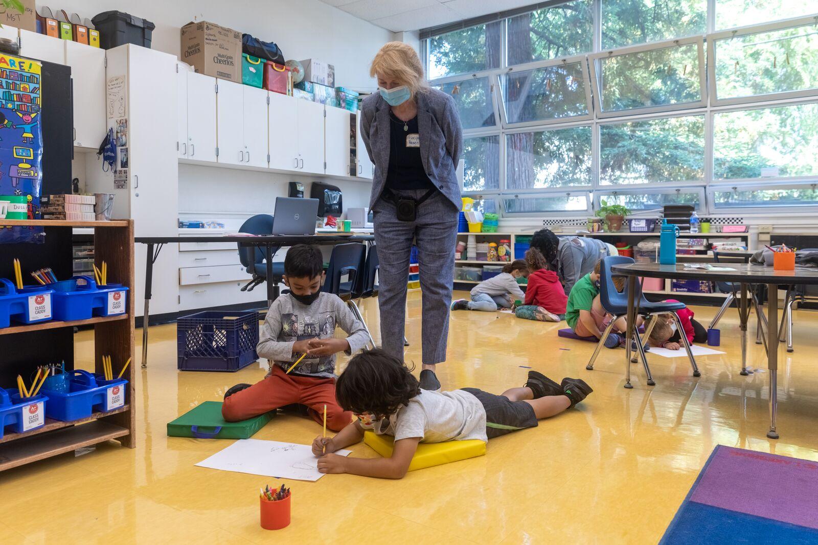 Washington Elementary School Principal Katia Hazen looks in on a first grade class  on August 16, 2021. Credit: Kelly Sullivan