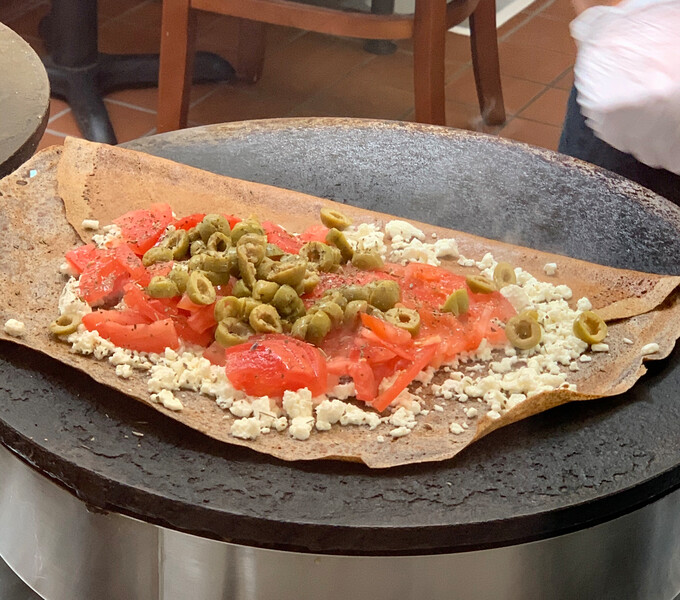 The vegetarian crepe, with green olives, feta cheese, tomato and herbes de Provence. Photo: Anna Mindess