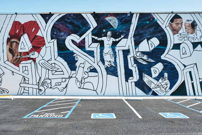 A mural in progress along the wall of the parking lot of the new West Berkeley Kaiser medical center courtesy of muralist Desi Mundo from the Community Rejuvenation Project, March 23, 2021 Photo: Pete Rosos