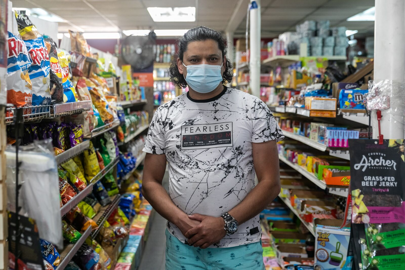 Vikas Aggarwal, owner of the Good 2 Go convenience store on Martin Luther King Jr. Blvd. is still requiring masks for staff at least through the end of the month, but customers are on the honor system if they come in unmasked. Credit: Kelly Sullivan