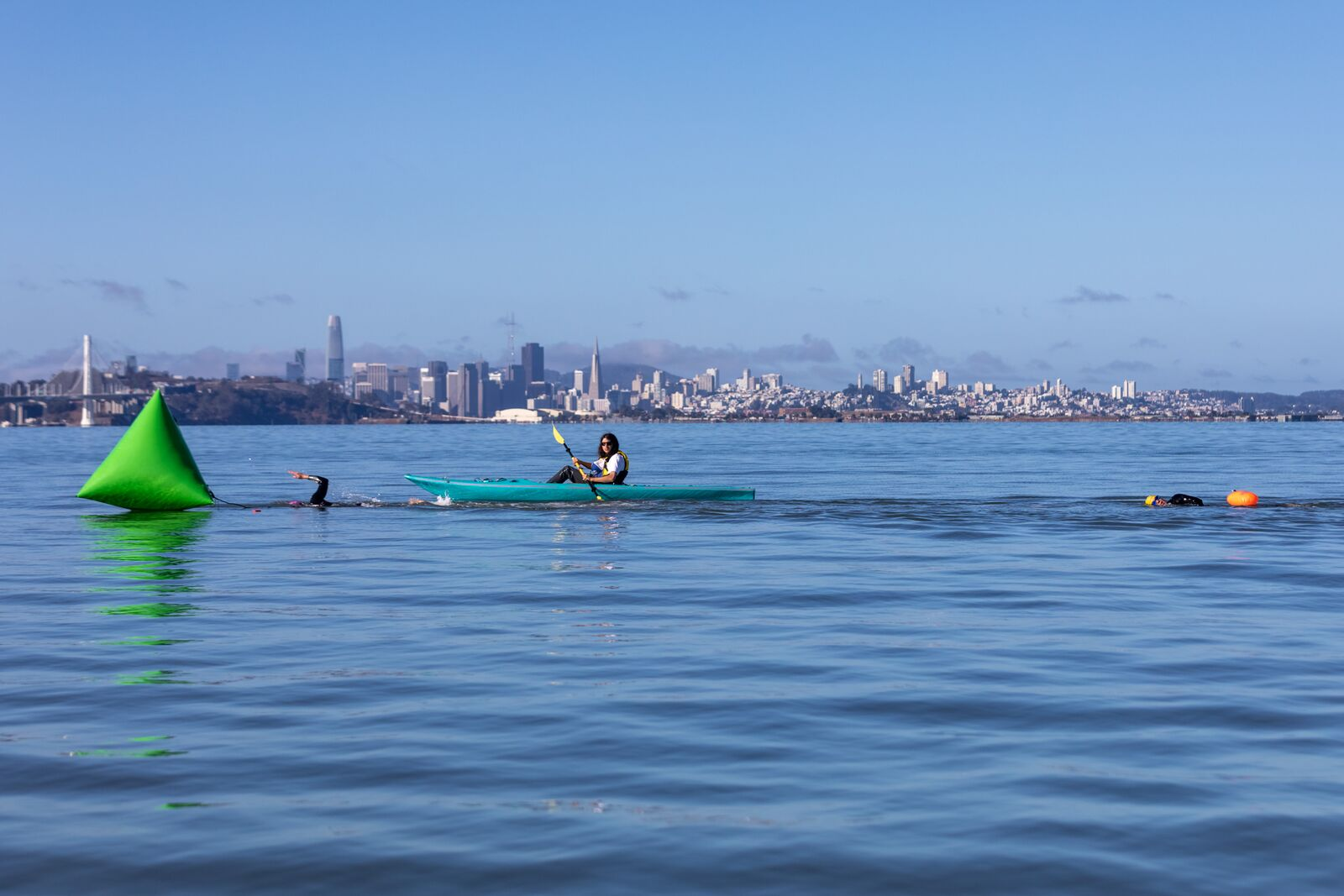 Odyssey open water swimmers navigate to a green buoy in the South Sailing Basin at the Berkeley Marina on September 19, 2021. Credit: Kelly Sullivan